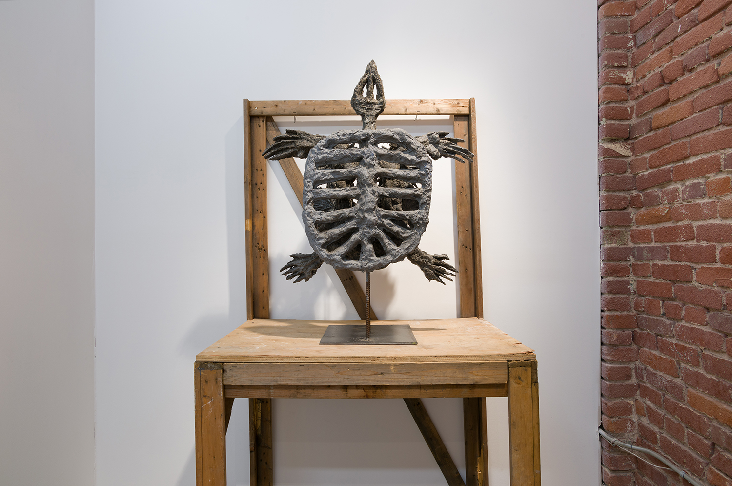 Evans Wittenberg,  Turtle,  2016,             cement, steel, 38 x 29 x 12 inches,                 table: wood, 24 x 38 x 72