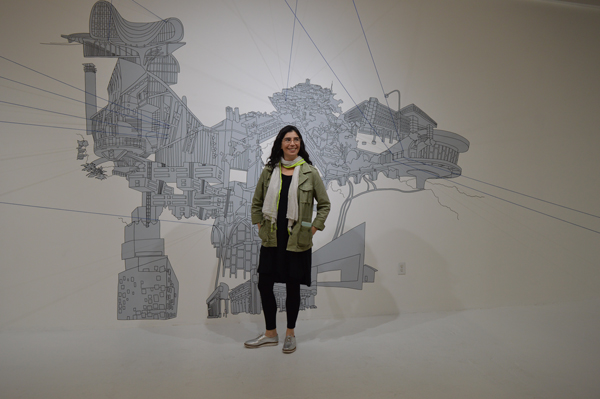 Kim Schoenstadt with her work at Chimento Contemporary © Artillery Magazine