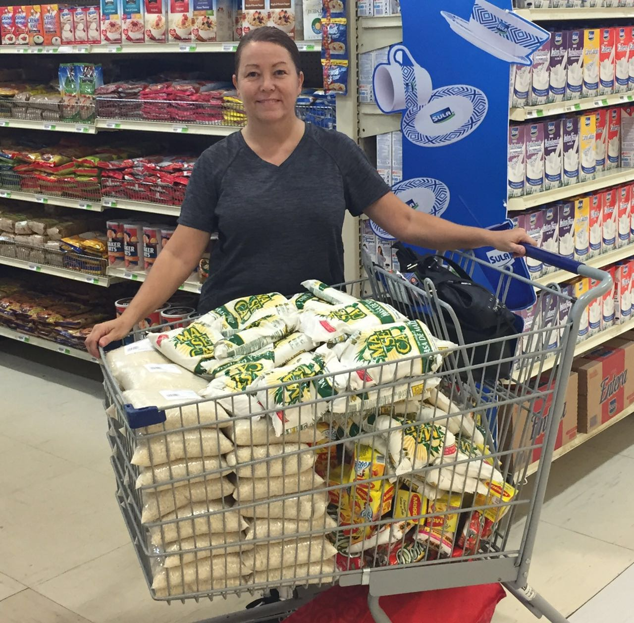 Our founder and missionary, Robyn, buying groceries to fill the back packs
