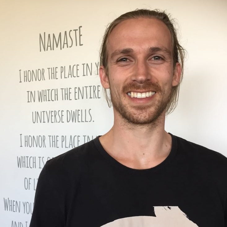 THOM OOSTERHOF-   RYT 200 Jayayoga   Thom's journey to Yoga began with his first ever class, taught by none other than our very own founder and lead teacher Jen. Thom's journey then led him to train with Jayayoga back in 2016 and has been teaching ever since. He has taken his teachings to Amsterdam and now returns to Auckland to continue his studies and further his teaching.  For Thom, Yoga is the portal to feeling grounded and centered yet full of vitality in both our bodies and minds. Through focusing on these key concepts, Thom teachings harness the power of breath work with the anatomy and dedication of the asanas. His aim is to allow students to further explore their bodies and bring awareness to the fluctuations of their minds. Through building on this bodily and mental awareness the practitioner comes into greater states of understanding and inner peace.