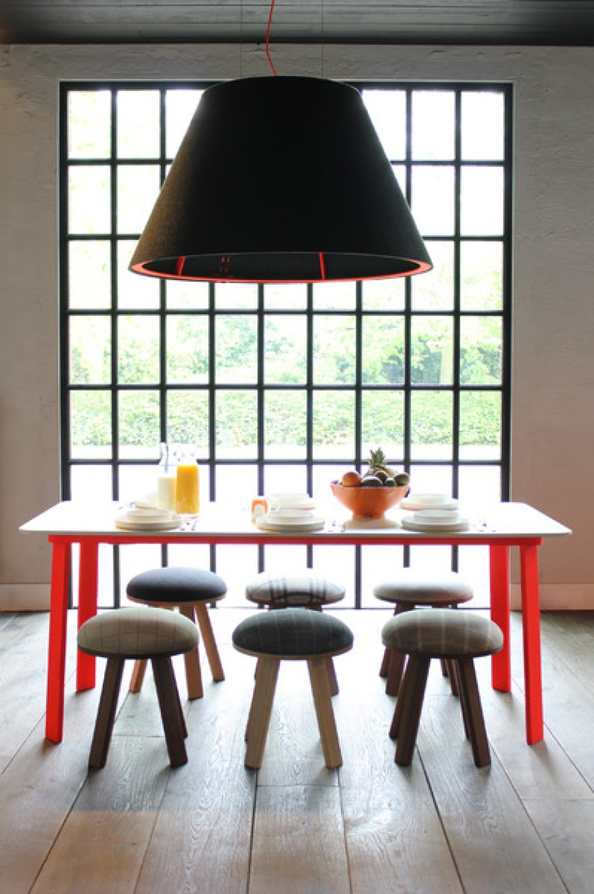 Red stitching on this BuzziShade felt fixture adds a color pop and helps to connect to the bold dining table /  Source