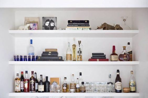 White floating shelves for a bar.jpg