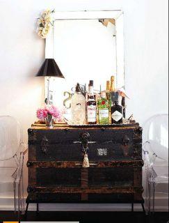 repurposed black trunk as bar cart.jpg