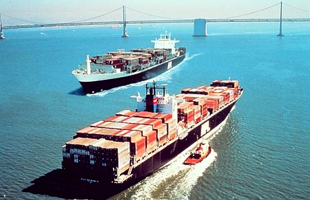 Containerships carrying international cargo.