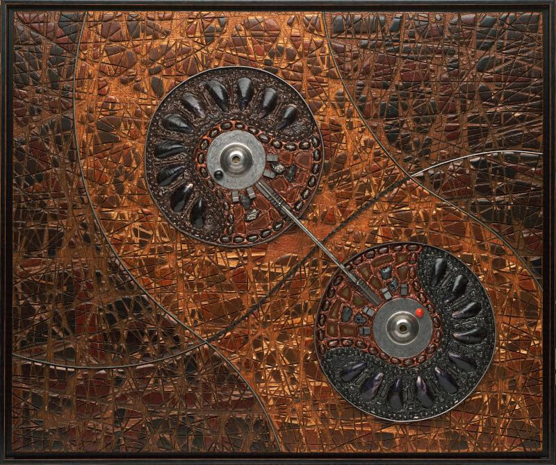 """From Jeff Grassie's show """"Turning the Ordinary Into the Extraordinary,'' at Willow Spring Vineyards, Haverhill, Mass., April 27-28. Mr. Grassie's experimental art creations use electric saws, chisels and other tools to create art made from wood, stone, metal, glass and other media."""