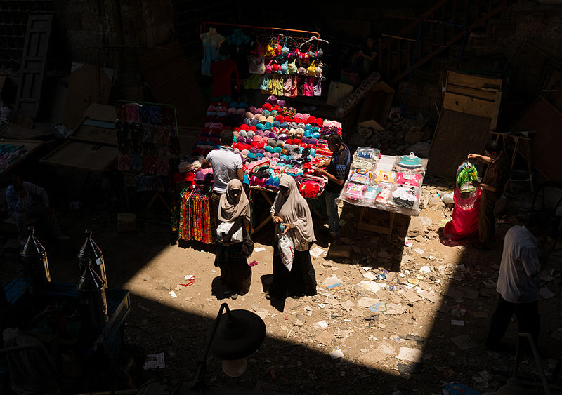 --Photo by Frank Schulenberg    Women shopping at a bazaar in Cairo .