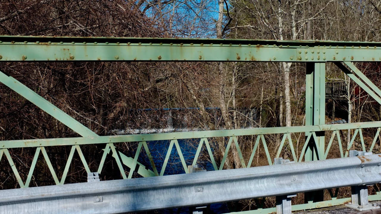 Abbott Run, with dam and mill pond beyond (now the Pawtucket Reservoir), the bridge is an early 20th-Century Pratt truss.