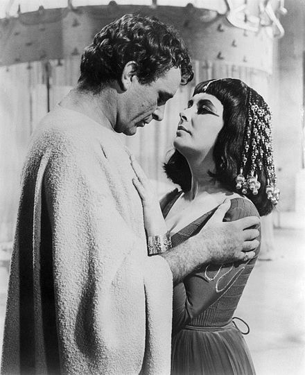 Richard Burton  as Mark Antony with Elizabeth Taylor as Cleopatra in the film epic  Cleopatra  (1963), the project in which they started their off-screen love affairs.