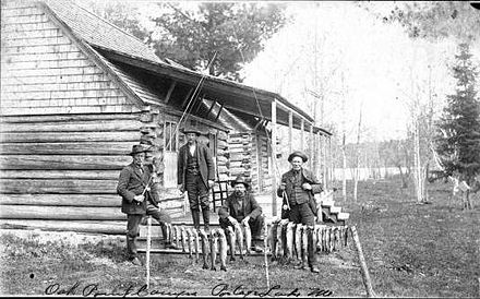 Successful fishermen at Oak Point Camps, Portage Lake, Maine, around 1900.