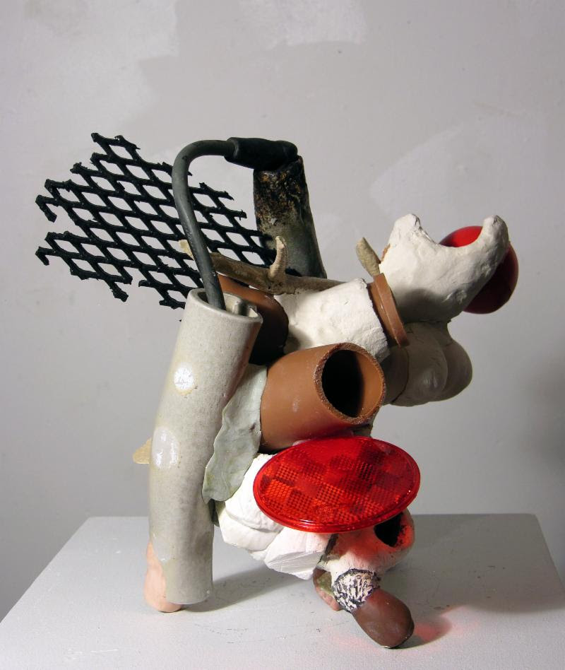 """""""Fused'' (mixed media), by Linda Leslie Brown, in her show """"Plastiglomerate,'' at Kingston Gallery, Boston, Oct. 3-28. The gallery says:    """"As a sculptor  Linda Leslie Brown 's work metaphorically plays with the literal and the imagined as seemingly random, mostly discarded materials interact to build works rife with allusions to the body. At the same time, her sculptural assemblages suggest the plastic, provisional and uncertain world of a new and transgenic nature where corporeal and mechanical entities recombine, serving as relics of possible futures and symbols of human behavior on the global environment. Her sculptures suggest a creaturely symbiosis as with holobionts: assemblages of different species that form ecological units.''"""