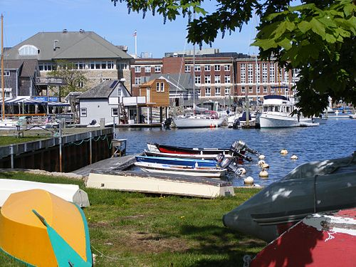 In Woods Hole, with research buildings. The village's two best-known institutions are the Woods Hole Oceanographic Institution and the Marine Biological Laboratory (whose work includes a major medical component).
