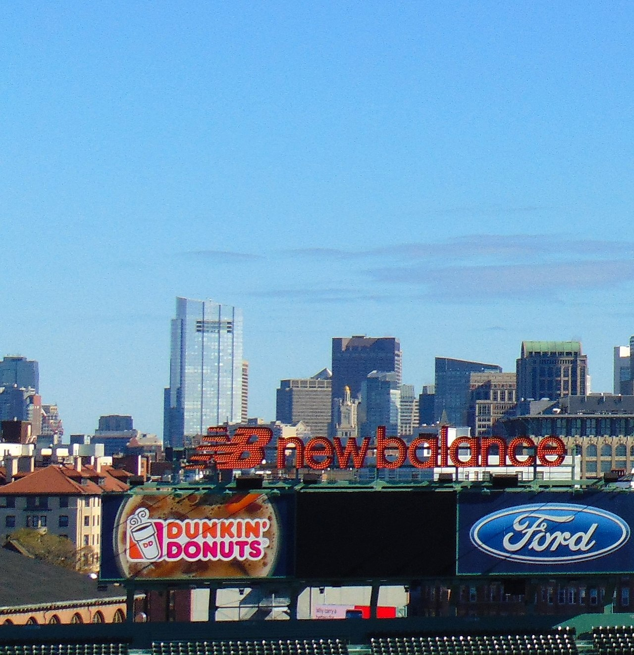 The Boston skyline from Fenway Park. The skyscraper in the left center is the newish Millennium Tower, where much of the space is held by absentee owners, some foreign. Real estate has long been an attractive investment for money launderers.    — Photo by JJBers