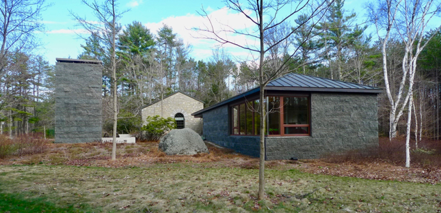 Outdoor fireplace, original library and new library.