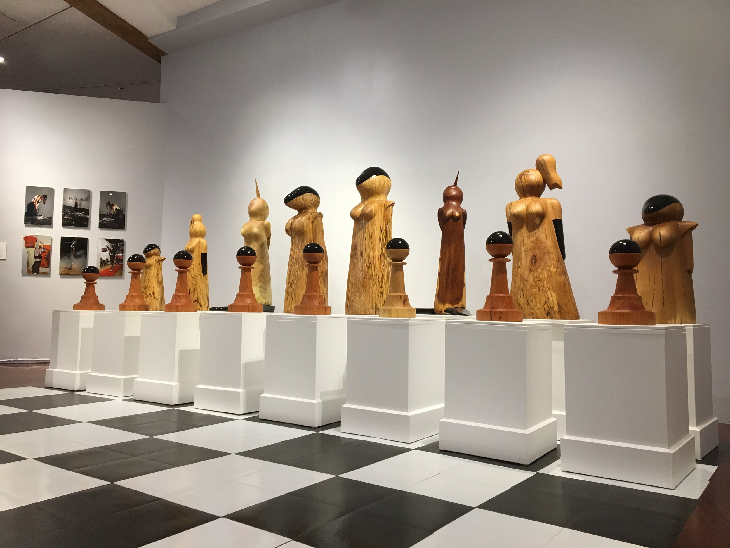 """""""March of the Matriarchs'' (wood sculptures), by Donna Dodson, in her current show, until Nov. 4, at Boston Sculptors Gallery."""