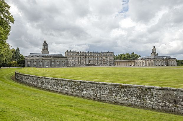 Ha-ha protecting the lawn at    Hopetoun House   ,    West Lothian   , Scotland. Note how the wall disappears from view as it curves away to the left of the picture .
