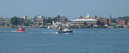 A view of    downtown    Woods Hole from the water, including Marine Biological Laboratory and the Woods Hole Oceanographic Institution.