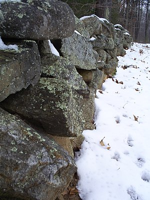 "Stone wall at what had been Robert Frost's farm in    Derry, N   .H., a wall he describes in his famous poem ""Mending Wall""."