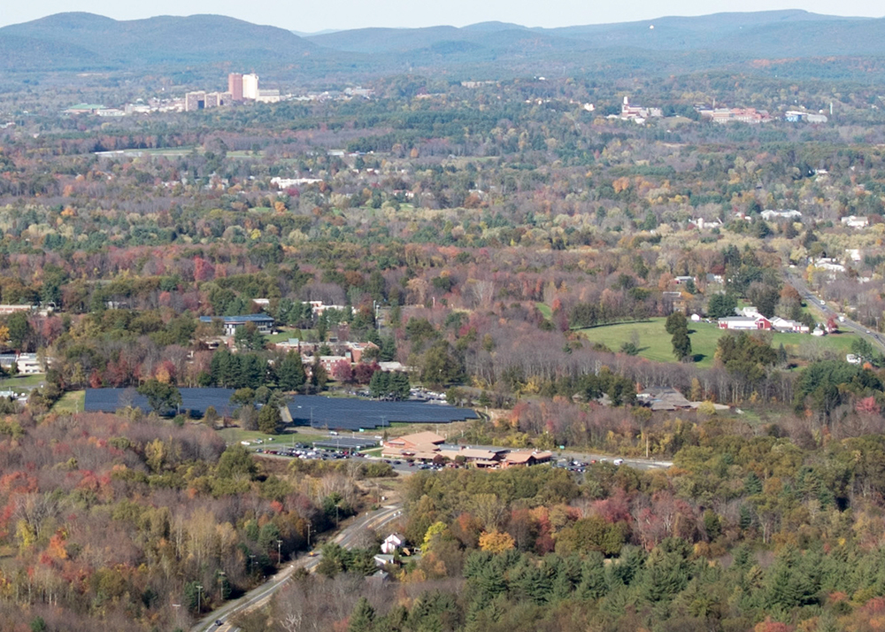 Hampshire College is in foreground, the University of Massachusetts at Amherst is in the upper left while Amherst College is in upper right. They comprise, with Smith and Mount Holyoke colleges, the Five College Consortium.    — Photo by MonsieurNapoleon