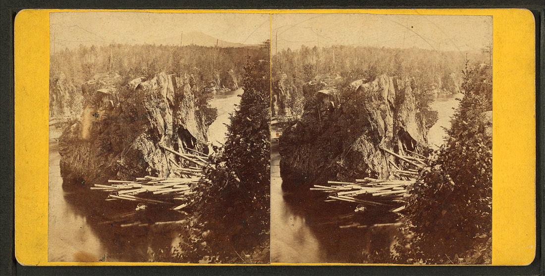 Log jam    at    Ripogenus Gorge   , in Maine. during 1870s    log driving   .
