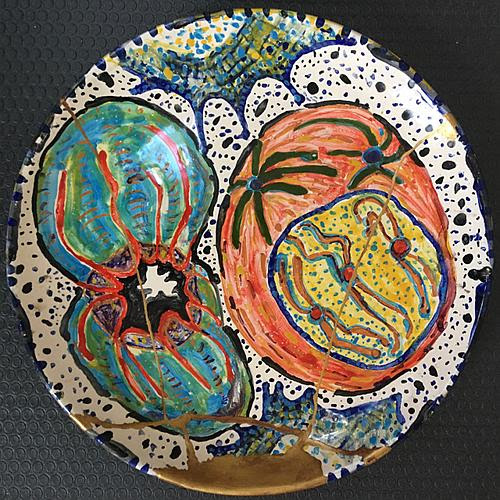 """""""Kintsugi Plate,'' by Christine Palamidessi, in the """"Wabi-Sabi'' show at Atlantic Works Gallery, Boston, through March 2.    This exhibition features the work of Palamidessi and Bo Petran in their experiments with classic Japanese aesthetic of Wabi-Sabi, which is based on an acceptance of imperfection and transience. Artscope says that Palamidessi calls the work """"irregular, intimate, unpretentious, earthy, murky, [and] simple."""" Palamidessi'   s    works include broken ceramic plates repaired via the Japanese art of kintsugi, and Petran has created a suspended wax-and-paper angel sculpture called """"Siddhartha''."""