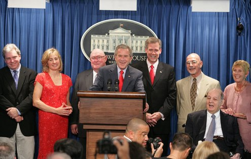 In August 2006, President    George W. Bush    hosted seven White House Press Secretaries before the    James S. Brady Press Briefing Room    underwent renovation. From left,    Joe Lockhart   ,    Dee Dee Myers   ,    Marlin Fitzwater   , Bush,    Tony Snow   ,    Ron Nessen    and    James Brady    (seated) with his wife,    Sarah Brady   .