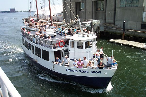 An MBTA ferry arrives at Rowe's Wharf, on the Boston waterfront. It's named after a popular historian of the New England coast.