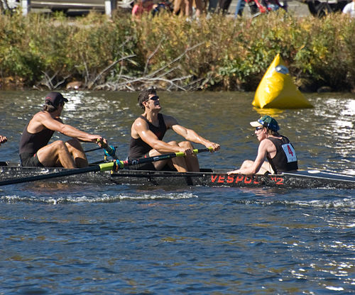 A coxswain (far right), sitting in the    stern   , facing the rowers, at the    Head of the Charles Regatta   , an annual event.