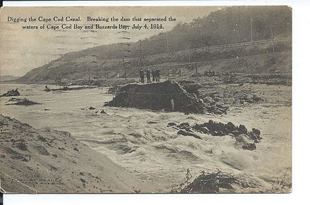 Postcard_view_of_breaking_the_dam_of_the_Cape_Cod_Canal,_July_1914.jpg