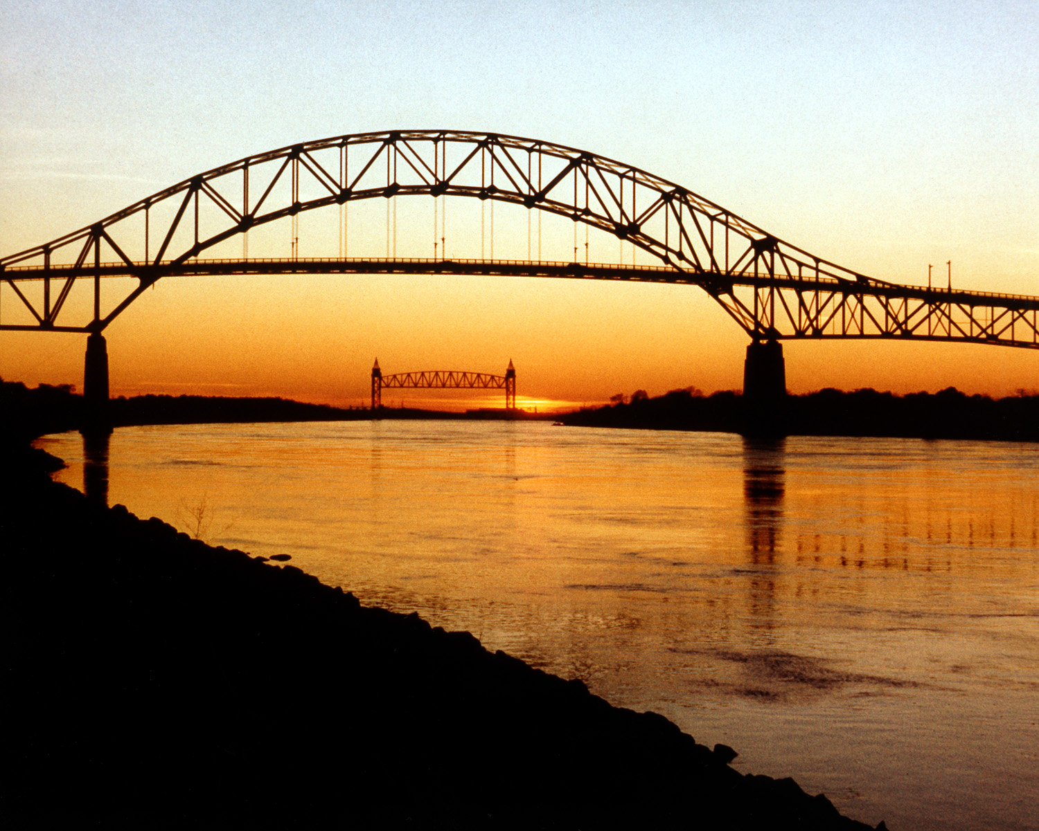 The Bourne Bridge over the Cape Cod Canal, with the Canal Railroad Bridge in the distance.