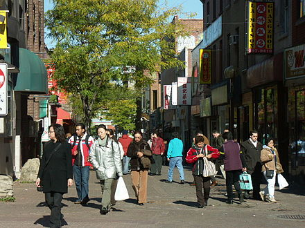 Walkers on Gauchetière Street, in    Montreal