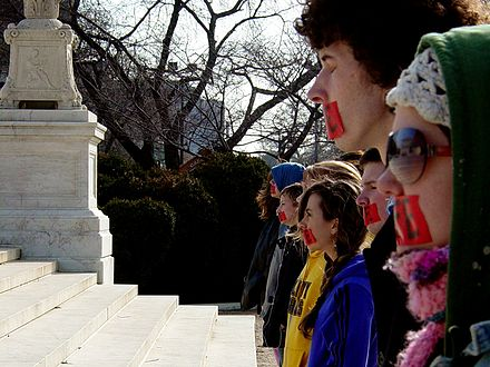 Members of  Bound4LIFE  in  Washington, D.C. , symbolically cover their mouths with red tape in anti-abortion demonstration.