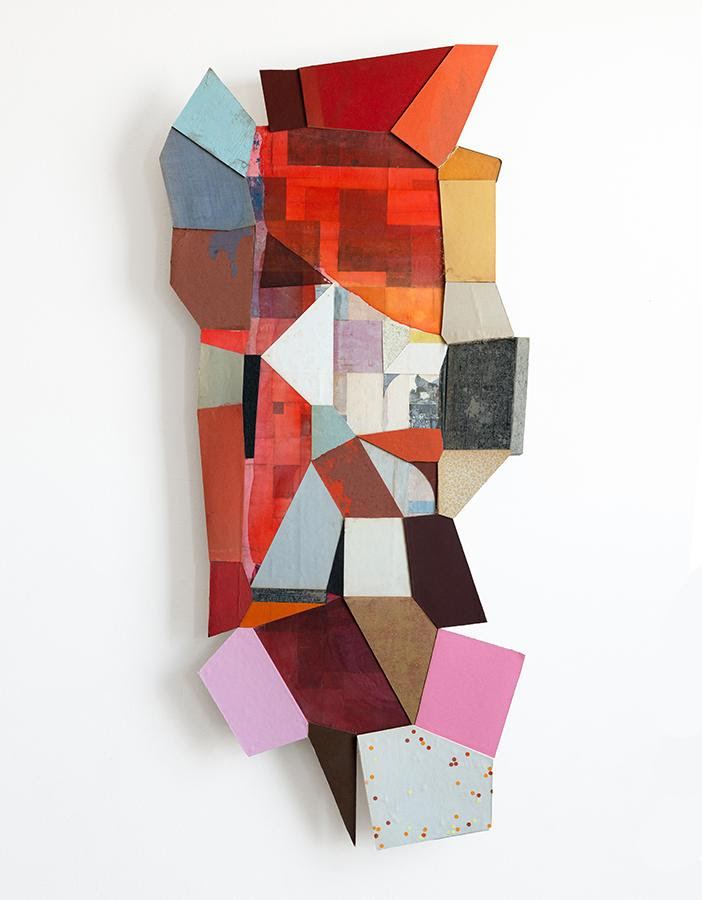 """""""Slowpoke'' (painted silk on vintage book paper collage), by Conny Goelz Schmitt, in her show """"Neverending Stories'' at Kingston Gallery, Boston, through June 30. The gallery explains: """"Her geometric collage work channels stories from the vintage books she uses to create her work. The collages, assemblages and sculptures play with deconstruction, reconstruction, and changing dimensionality – often in one piece. Interactive sculptures offer different viewpoints of stories. Small work on vintage book boards invites the viewer to make up their own story and wall objects seemingly tell stories on another level. The work leads to new interpretations of past and present and opens up the viewer's outlook to the future.''"""