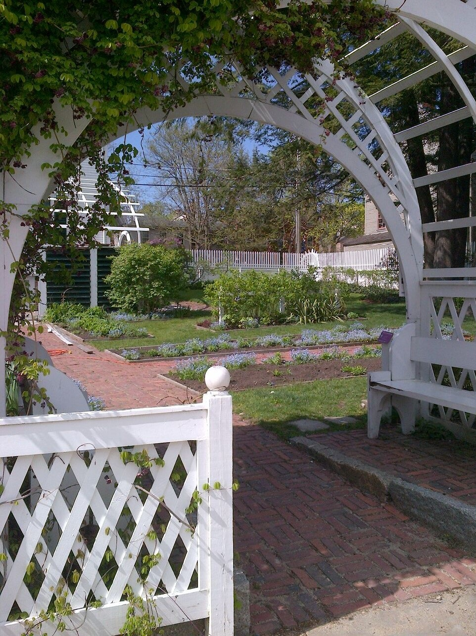 Entrance to the Aldrich Garden in Strawberry Banke, a historical neighborhood and museum in Portsmouth, N.H. ,featuring 37 restored buildings erected between the 17th and early 19th centuries.    — Photo by Sseacord