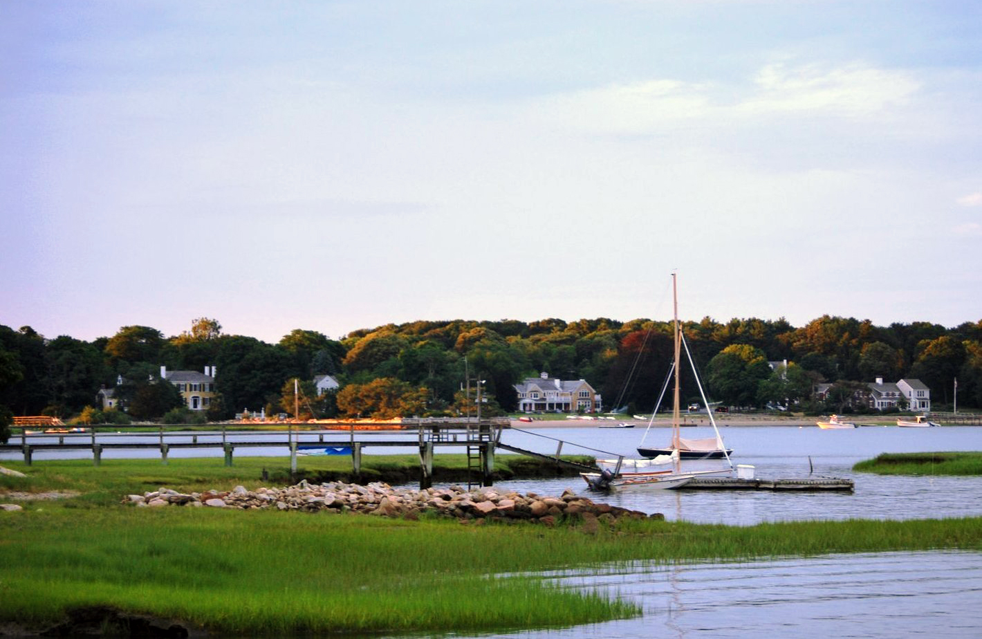 "In Duxbury, view of Bluefish River inlet, with ""King Caesar House'' at left. The Federal-style mansion was built in 1809 for Ezra Weston, a well known shipbuilder and merchant nicknamed King Caesar for his influence and prosperity.    — Photo by Ruth W. Demby"