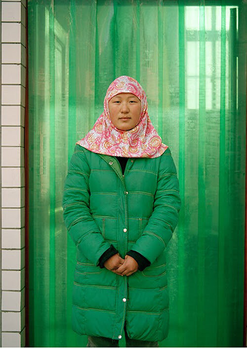 """Muslim Girl #14'' (archival pigment print,) by Lili Almog, from the series  "" The Other Half of the Sky''   in the group show ""Crossing Lines, Constructing Home: Displacement and Belonging in Contemporary Art,'' though Jan. 4 at Harvard Art Museums/Fogg Museum, Cambridge, Mass.    The show explores displacement by examining in-depth both the historical context and causes of migration as well as firsthand narratives from migrants and refugees . "" Crossing Lines''   contains 40 artworks in a variety of mediums."