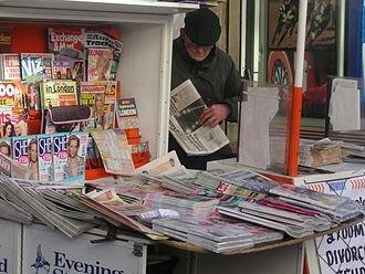 330px-Newspaper_vendor.jpg