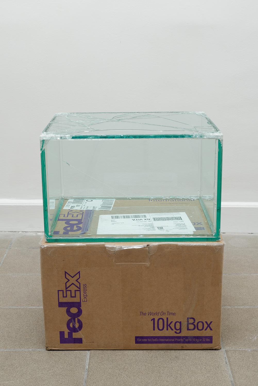 FedEx® 10kg Box  © 2006 FedEx 149801 REV 9/06 MP, International Priority, Los Angeles-Paris trk#796906988159, October 14-16, 2013    2013–   Laminated glass, FedEx shipping box, accrued FedEx shipping and tracking labels, silicone, metal, tape  10 1/2 x 16 1/4 x 13 1/4 inches   FedEx Glass Works, 2007–