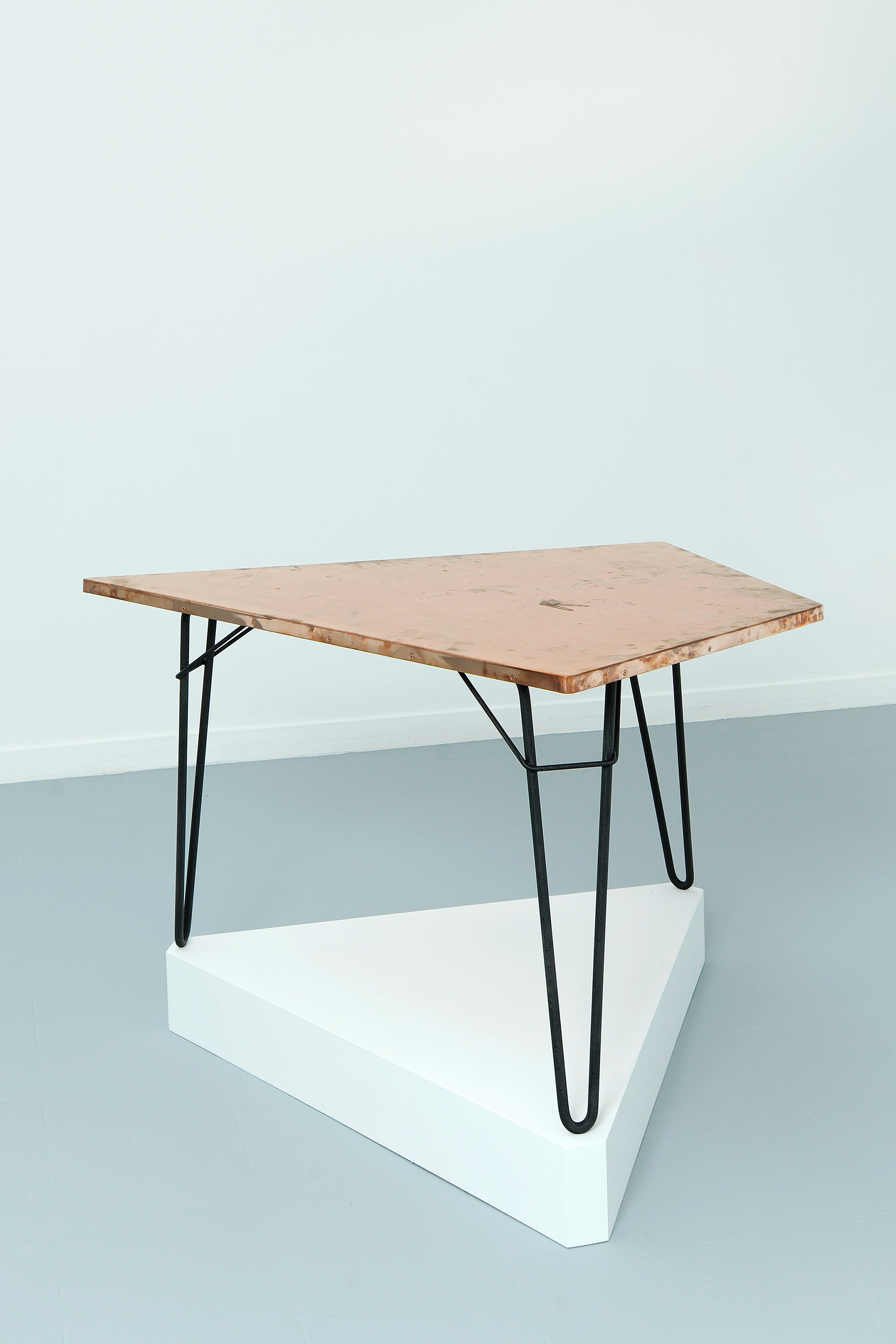 Copper Surrogate (Table: designed by Willy Van der Meeren, 1958; Galerie Rodolphe Janssen, Brussels, Belgium, August 10th–September 2nd, 2011)    2011   Polished copper table top and powder-coat steel  Table: 39 3/4 x 26 1/2 x 1 inches   Surrogates (Tabletop and Desktop), 2008–