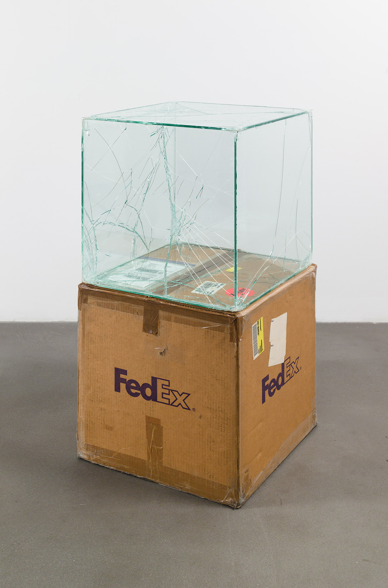FedEx® Large Kraft Box  © 2005 FEDEX 330508 REV 10/05 SSCC, International Priority, Los Angeles–Brussels trk#865282057975, October 27–30, 2008, International Priority, Brussels–Los Angeles trk#866071746396, December 8–9, 2008, Standard Overnight, Los Angeles–New York trk#774901659423, November 4–5, 2015, Standard Overnight, New York–Los Angeles trk#775241449093, December 21–22, 2015    2008–   Laminated glass, FedEx shipping box, accrued FedEx shipping and tracking labels, silicone, metal, tape  20 x 20 x 20 inches   FedEx Glass Works, 2007–