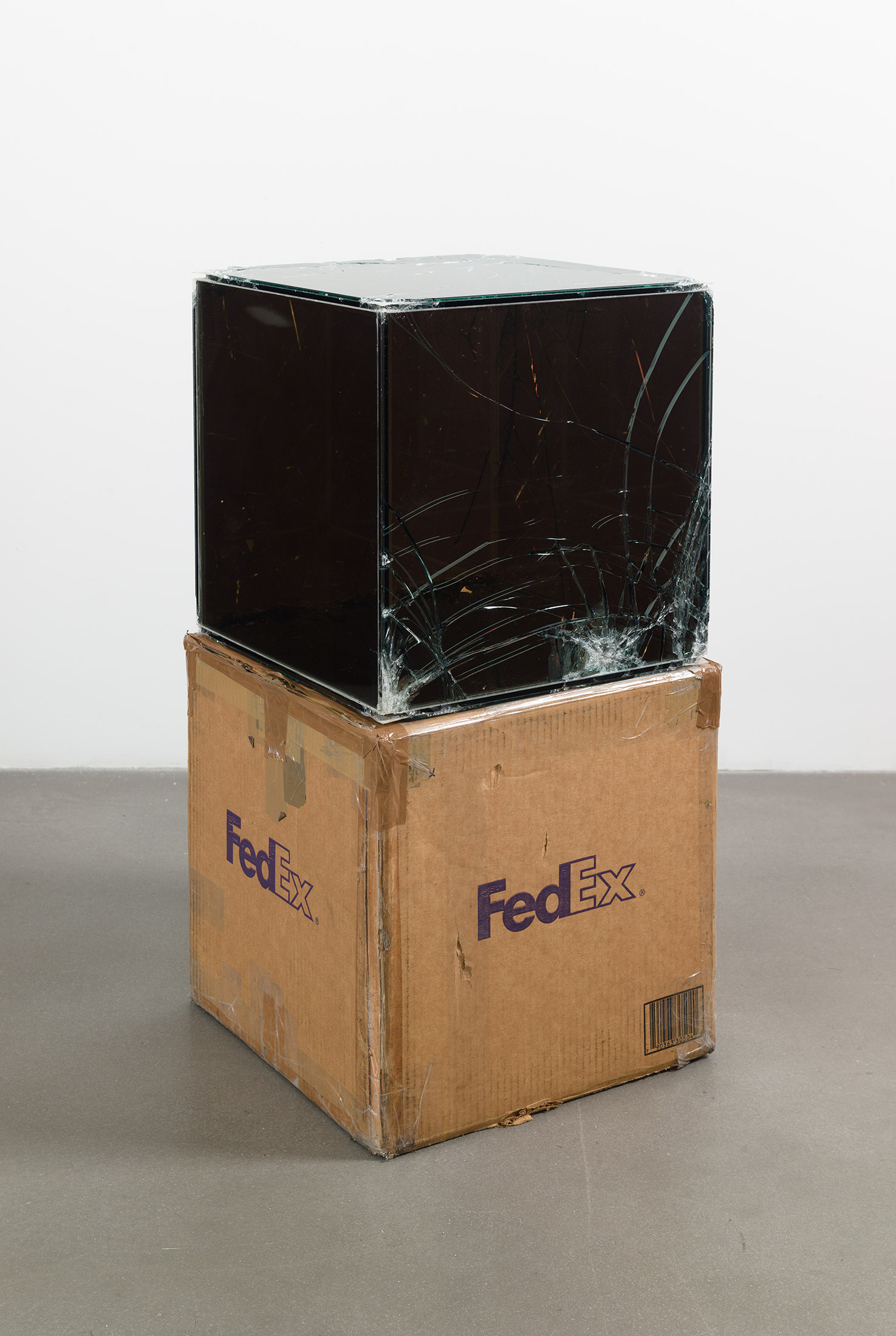 FedEx® Kraft Box  © 2005 FEDEX 330504 10/05 SSCC, Priority Overnight, Los Angeles–Miami trk#865344981358, October 29–30, 2008, Priority Overnight, Miami–Ann Arbor trk#861049125126, March 3–4, 2009, Standard Overnight, Ann Arbor–Los Angeles trk#868274625760, July 9–10, 2009, Standard Overnight, Los Angeles–New York trk#774901687401, November 4–5, 2015, Standard Overnight, New York–Los Angeles trk#775241470240, December 21–22, 2015    2008–   Laminated Mirropane, FedEx shipping box, accrued FedEx shipping and tracking labels, silicone, metal, tape  16 x 16 x 16 inches   FedEx Glass Works, 2007–