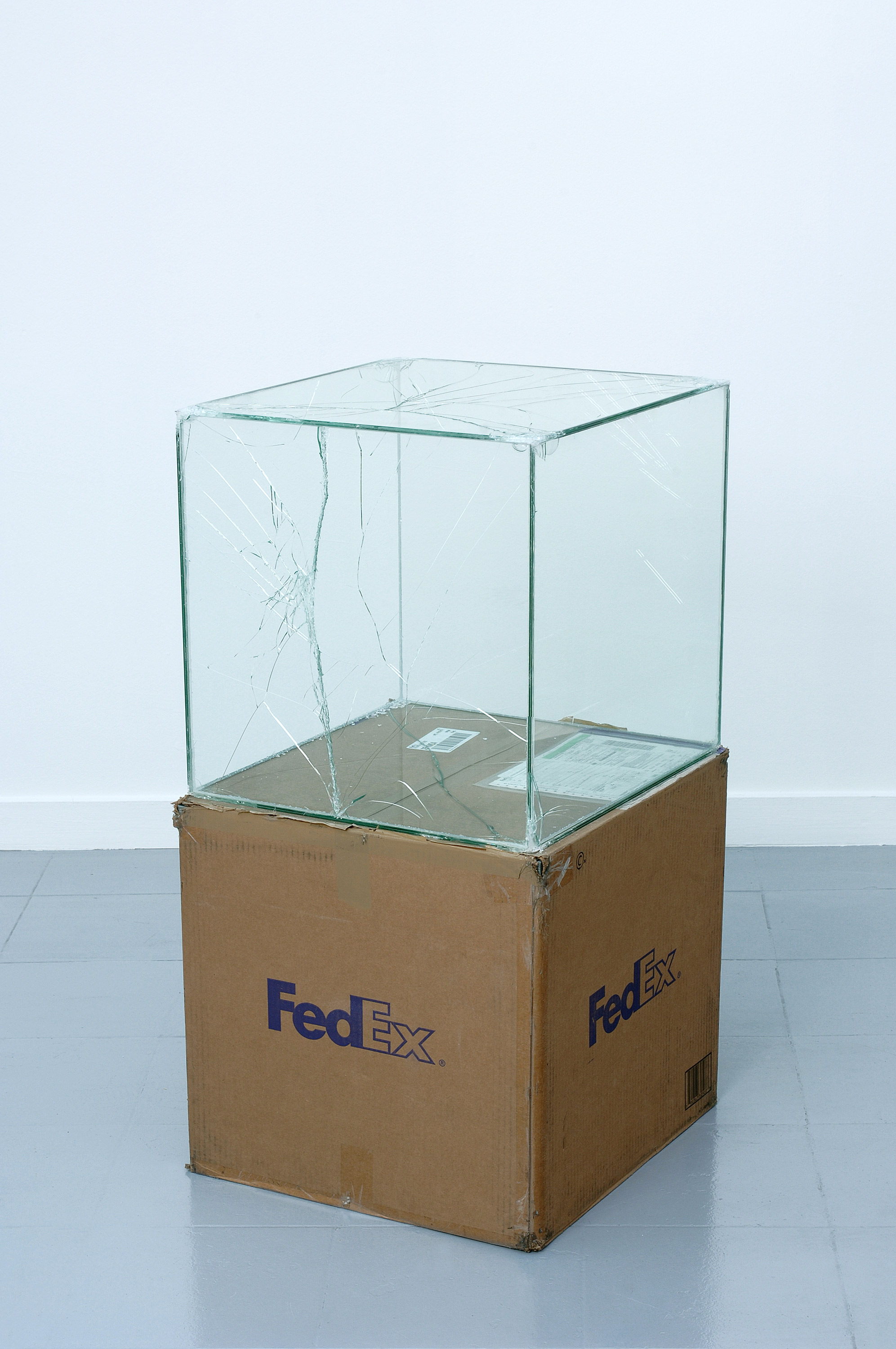FedEx® Large Kraft Box  © 2005 FEDEX 330508 REV 10/05 SSCC, International Priority, Los Angeles–Brussels trk#865282057975, October 27–30, 2008, International Priority, Brussels–Los Angeles trk#866071746396, December 8–9, 2008, Standard Overnight, Los Angeles–New York trk#774901659423, November 4–5, 2015, Standard Overnight, New York–Los Angeles trk#775241449093, December 21–22, 2015    2008–   Laminated glass, FedEx shipping box, accrued FedEx shipping and tracking labels, silicone, metal, and tape  20 x 20 x 20 inches   FedEx Glass Works, 2007–
