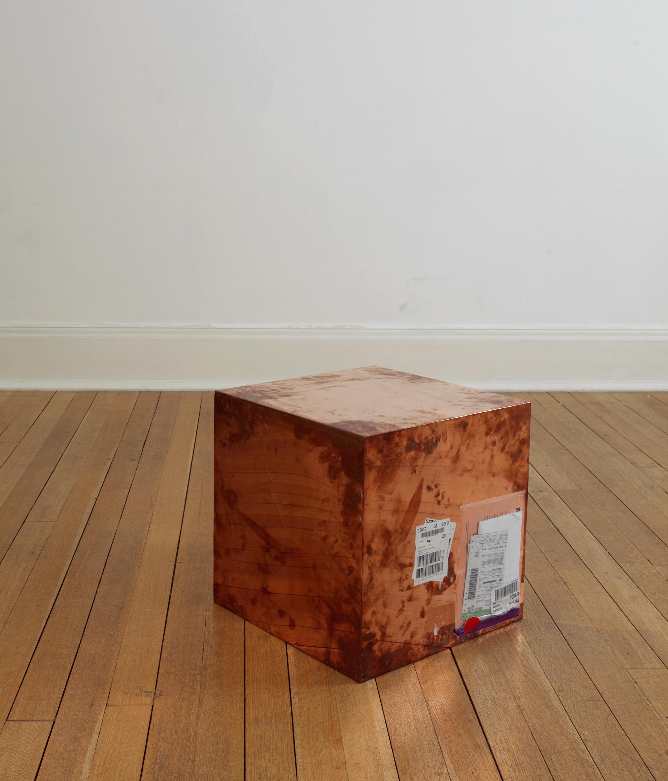 FedEx® Large Kraft Box  © 2005 FEDEX 330508 REV 10/05 SSCC, International Priority, Los Angeles–London trk#868587728040, October 02–05, 2009, International Priority, London–New York trk#863822956489, November 18–20, 2009, International Priority, New York–London trk#795200981790, September 19–21, 2011    2009–   Polished copper, accrued FedEx shipping and tracking labels  20 x 20 x 20 inches   FedEx Copper Works, 2009–