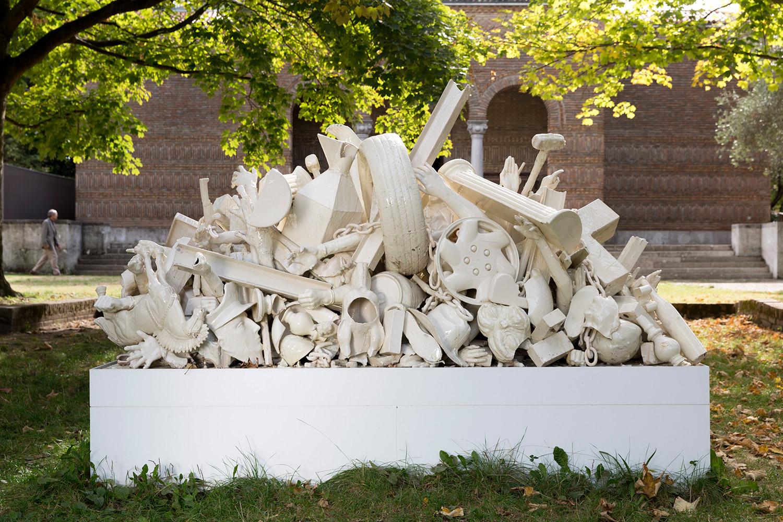 Luchas Fraticidas (March 2–8, 2015: Cerámica Suro Contemporánea, Guadalajara, Jalisco, Mexico)    2015   Ceramica Suro slip cast remnants, glaze, and firing plates  71 x 99 1/2 x 42 1/4 inches   All the World's Futures, 2015