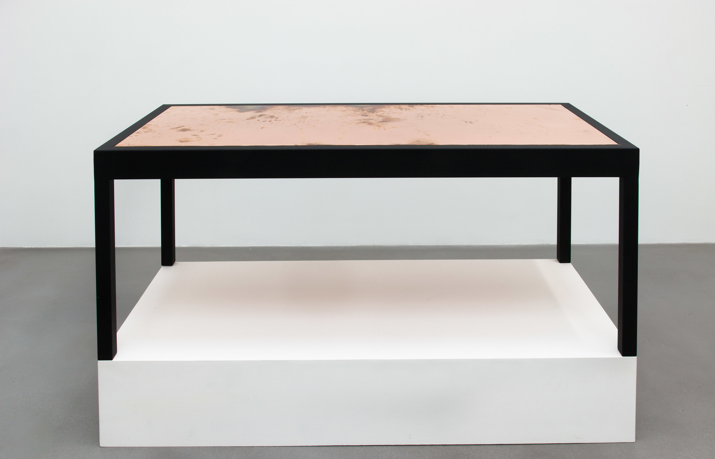 Desk [Source: wood and leather desk designed by BassamFellows from the office of Friedrich Petzel at Friedrich Petzel Gallery, New York. Surrogate: WB72414 (produced in conjunction with Friedrich Petzel, Owner), Copper Surrogate (designed by BassamFellows, 456 West 18th Street, New York, New York, June 26–October 4, 2014), conceived in 2013, produced in 2014, made of polished copper and powder-coated steel with the dimensions 33 1/2 x 72 x 1 1/2 inches. Production completed by Benchmark Scenery Incorporated, Glendale, California from 48 ounce Electrolytic-Tough-Pitch C11000 Copper Alloy cut from 60 x 120 inch mirror-polished sheet and 24 ounce Electrolytic-Tough-Pitch C11000 Copper Alloy cut from 60 x 120 inch mirror-polished sheet, with formed corners where necessary, copper plated hardware, perimeter edge French cleat system, and separate black powder-coated steel support structures. $12,076.00 production cost including travel and storage crates with floating lockable cleat system. Unexposed surrogates shipped by Crate 88 Incorporated from Los Angeles to New York, June 19 through June 23, 2014. Installed in place of BassamFellows desk at 456 West 18th Street, New York on June 26, 2014, exposure through the duration of A Machinery for Living organized by Walead Beshty and Walead Beshty: Performances Under Working Conditions at Friedrich Petzel Gallery, New York, closing October 4, 2014. Desk has one base surrogate with the dimensions 28 1/2 x 71 5/8 x 33 1/2 inches.]    2014   Polished copper table top and powder-coated steel  Table: 1 1/2 x 72 x 33 7/16 inches; Base: 28 1/2 x 71 5/8 x 33 1/2 inches