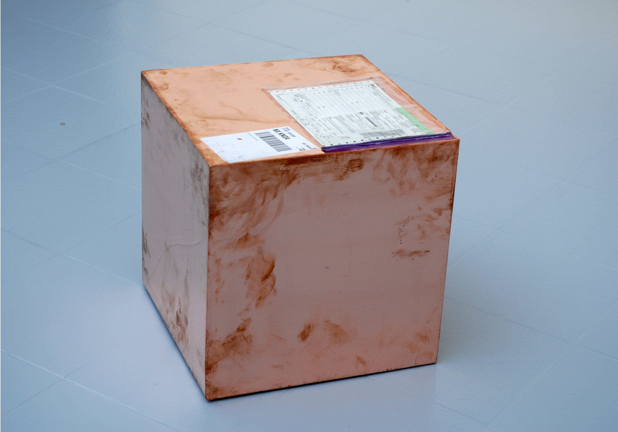 16-inch Copper (FedEx® Kraft Box  © 2005 FEDEX 330504 10/05 SSCC), International Priority, Los Angeles–Brussels trk#861718438308, August 31–September 2, 2011   2011–  Polished copper, accrued FedEx shipping and tracking labels  16 x 16 x 16 inches   FedEx Copper Works, 2009    Diapositives, 2011