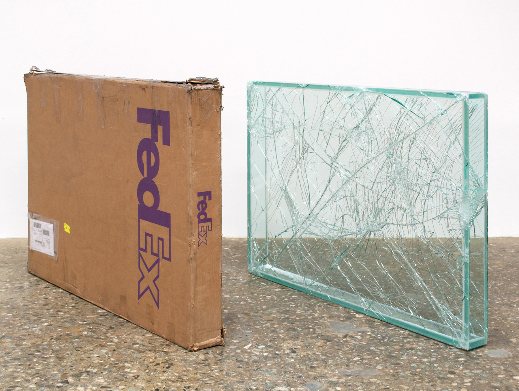 FedEx® Large Framed Art Box  © 2011 FedEx 163098 REV 7/11 Standard Overnight, Los Angeles–New York trk#798451863810, May 30–31, 2012, Standard Overnight, New York–Los Angeles trk#793621370900, May 31–June 1, 2012    2012–   Laminated glass, FedEx shipping box, accrued FedEx shipping and tracking labels, silicone, metal, tape  36 11/16 x 49 3/8 x 4 3/4 inches