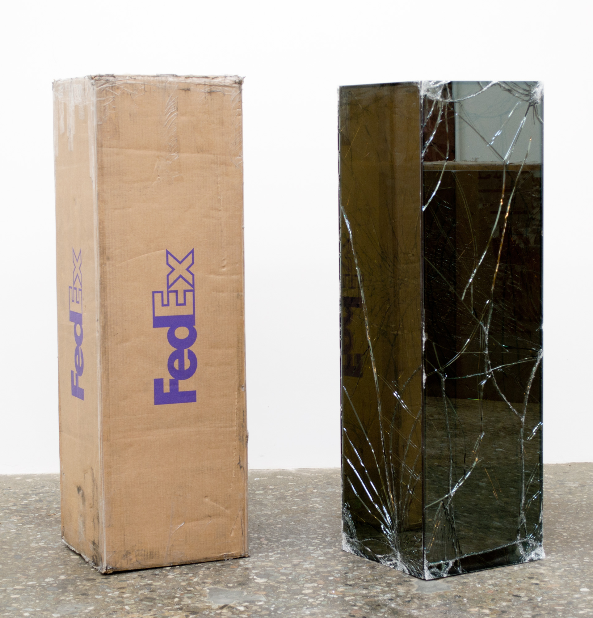 FedEx® Golf-Bag Box  © 2010 FedEx 163166 REV 10/10 Standard Overnight, Los Angeles–New York trk#793767865564, July 10–11, 2012, Standard Overnight, New York–Los Angeles trk#793767890360, July 11–12, 2012    2012–   Laminated glass, FedEx shipping box, accrued FedEx shipping and tracking labels, silicone, metal, tape  48 x 15 x 15 inches