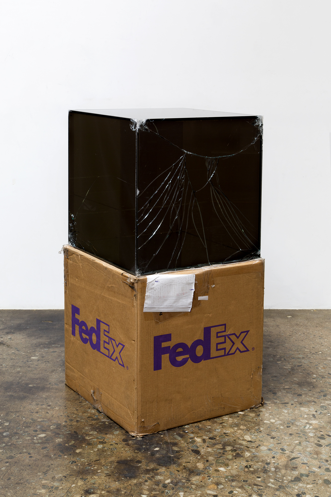 FedEx® Large Kraft Box  © 2008 FEDEX 330510 REV 6/08 GP, International Priority, Los Angeles–Tokyo trk#778608488323, March 9–13, 2017, International Priority, Tokyo–Los Angeles trk#805795452215, July 13–14, 2017   2017–  laminated Mirropane, FedEx shipping box, accrued FedEx shipping and tracking labels, silicone, metal, tape  24 x 24 x 24 inches   Transparencies, 2017