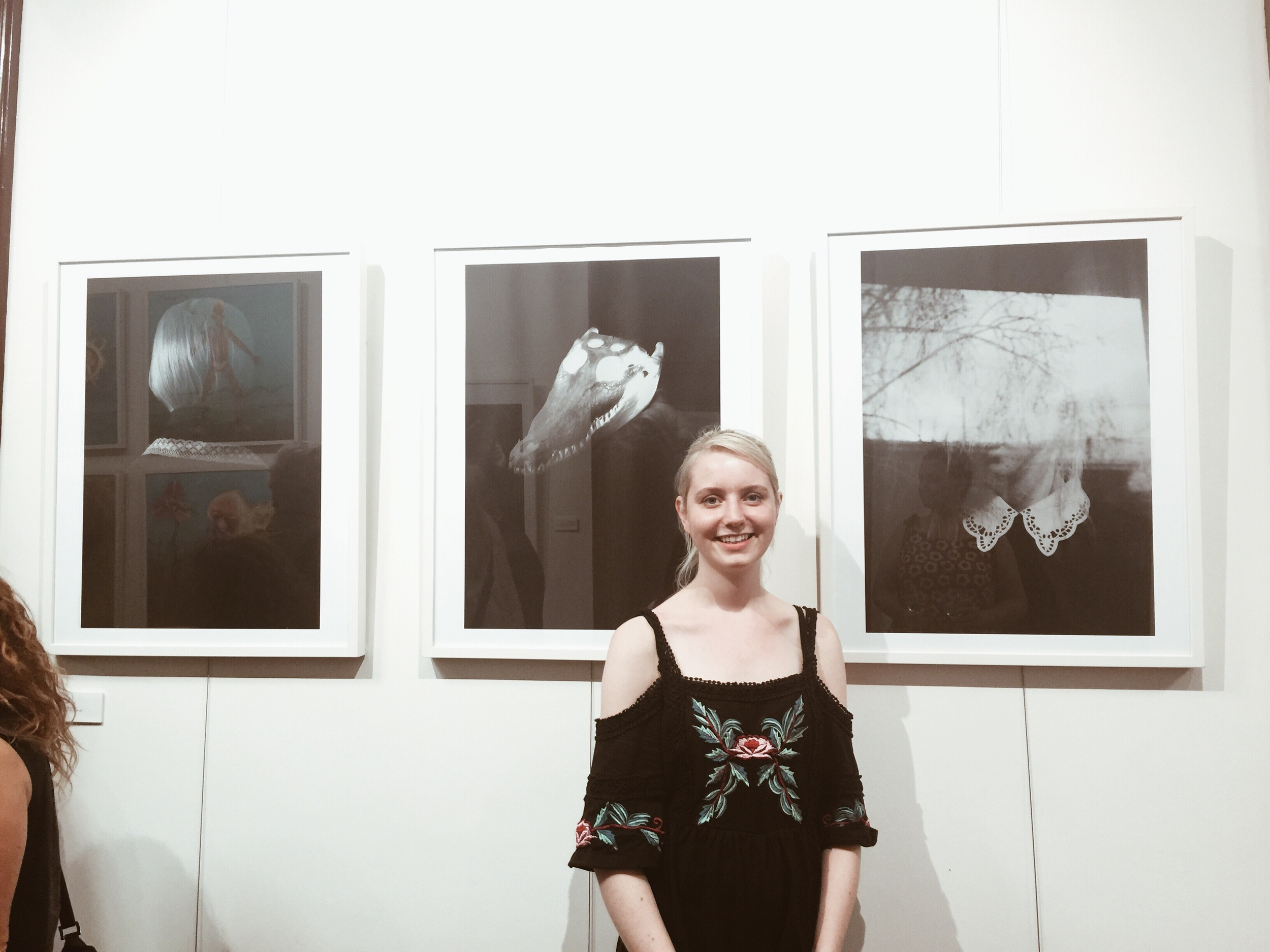 Sophie in front of her work 'BLANK SPACE'