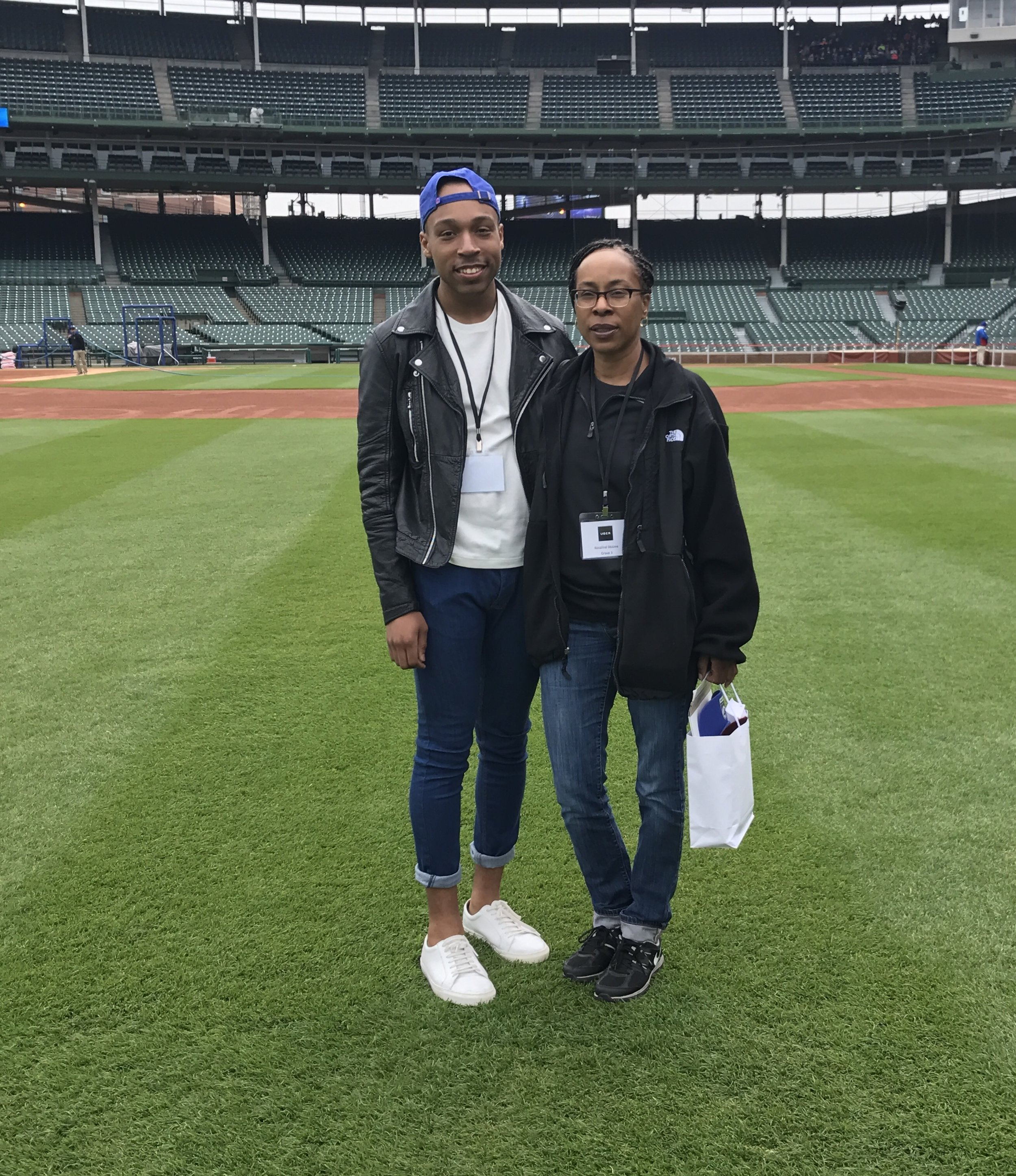 Here's an example of not standing out because I stragetigally wore blue jeans to attempt fitting in at Wrigley. I never wear blue jeans. This was the first time I had in years, and my mother was shook.